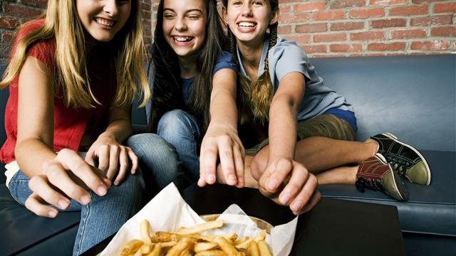 Teens Eating Fries at Bowling Alley.jpg